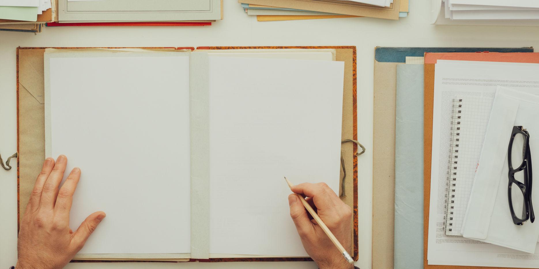 office-worker-writing-paperwork
